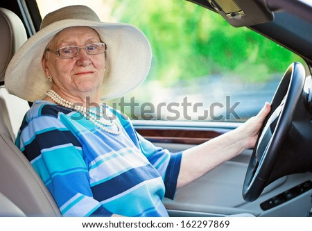 active mature woman in a car - stock photo