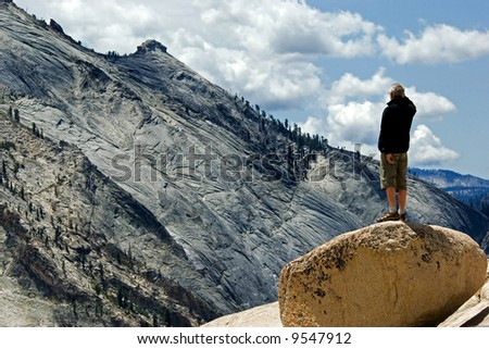 Active middle aged man observing Yosemite national park - stock photo