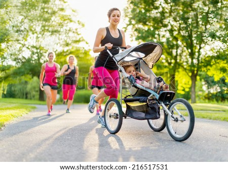 active mother jogging - stock photo