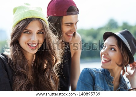 Active people. Closeup of group of young two women and one man. Outdoors, lifestyle - stock photo