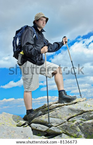 Active people - Person climbing a cliff - stock photo