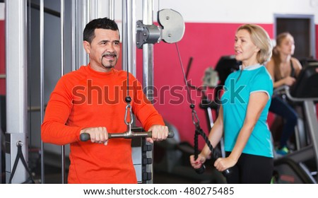 Active people  weightlifting training in modern health club