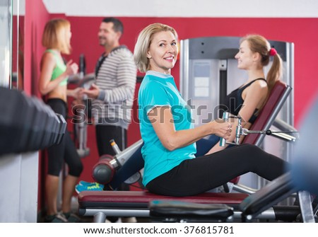 Active positive glad people  weightlifting training in modern health club