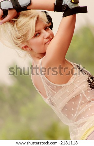 Active pretty girl portrait on green background - stock photo