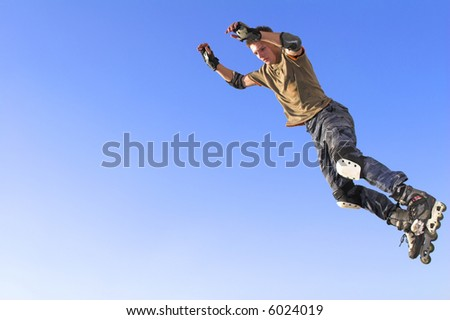 Active  roller boy  jumping from parapet on the blue sky