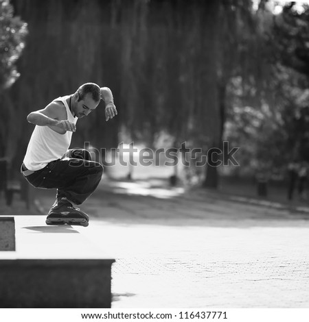 active roller in the park. black and white - stock photo