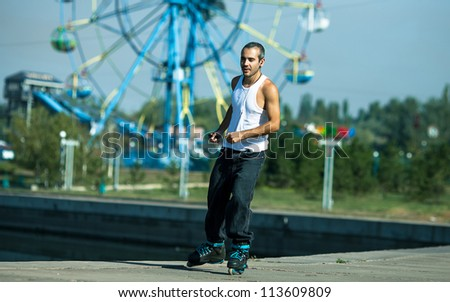 active roller riding  in the park, beautiful  background - stock photo