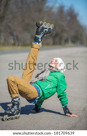 Active roller skating in the park having fun on a sunny day - stock photo