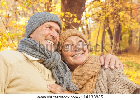 active senior couple enjoying freetime park - stock photo