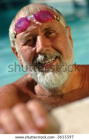 Active senior man in the swimming pool, working out in the water