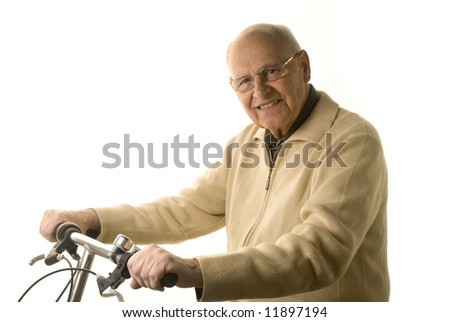 Active senior man riding his bike isolated on white - stock photo