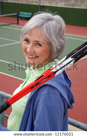 Active senior on the tennis court. - stock photo