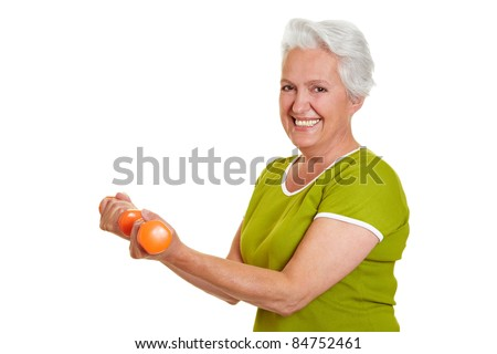 Active senior woman at fitness training with dumbbells - stock photo