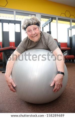 Active senior woman exercising at the gym - stock photo