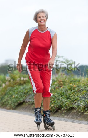 Active senior woman skating - stock photo