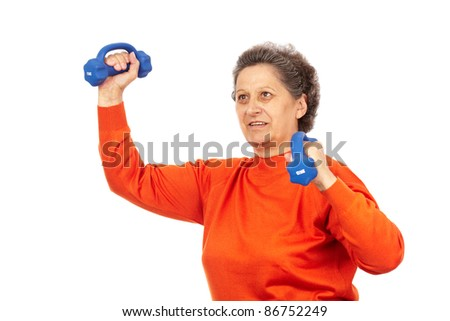 Active senior woman with dumbbells training, isolated on white