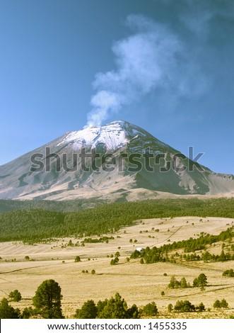 Active snowcapped Popocatepetl volcano (5.452 meters), Mexico - stock photo