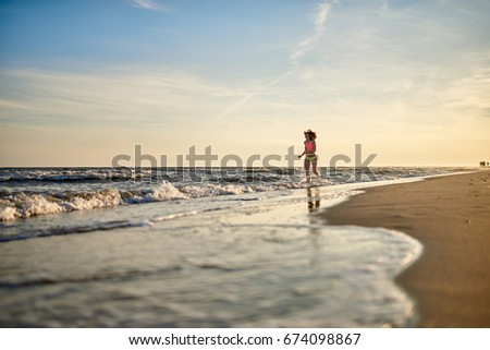 Active Sport Girl Runs Along The Beach Sunset