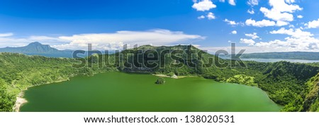 active taal volcano inside bigger crater lake near tagaytay in the philippines - stock photo