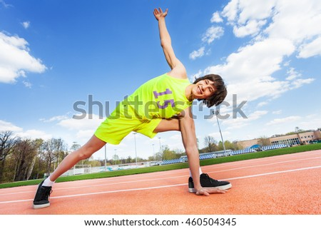 Active teenage athlete exercising outdoor