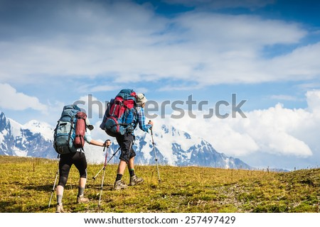 Active travelers in hike in the mountains. Sport lifestyle travel concept - stock photo