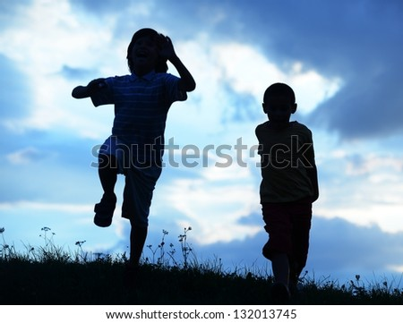 Active two kids spending happy time on summer nature - stock photo