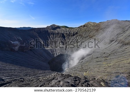 Active volcanic crater of Mount Bromo in East Java, Indonesia - stock photo
