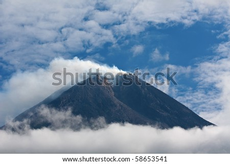 Active volcano Merapi on the east of Java island - stock photo