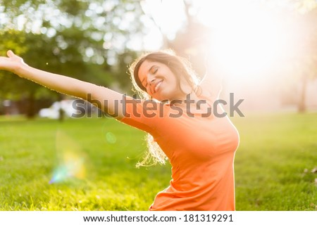 Active woman doing yoga poses at sunset - stock photo