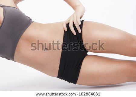 Active woman exercise her abs - stock photo