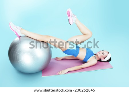 Active Woman exercising with Fitness Ball. Workout - stock photo
