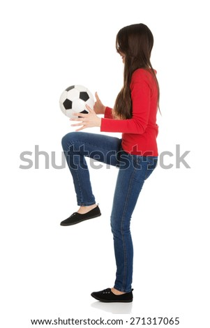 Active woman with a soccer ball. - stock photo