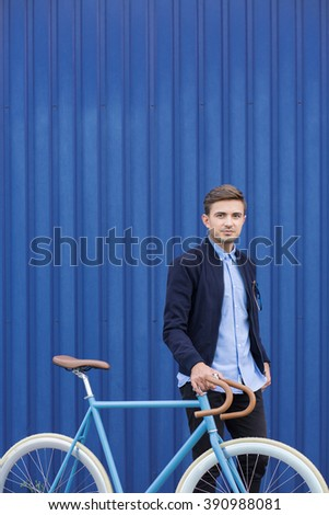 Active young businessman riding bicycle to work - stock photo
