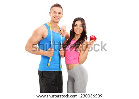 Active young couple posing with an apple isolated on white background - stock photo