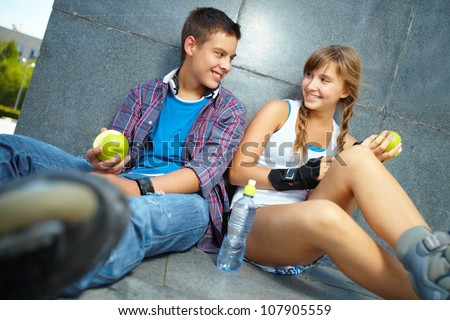 Active young people eating healthy food to stay fit - stock photo