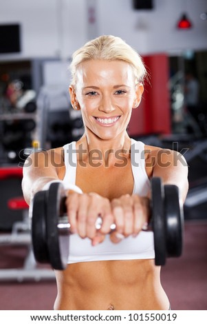 active young woman doing workout using dumbbell - stock photo