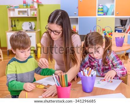 Activities for Preschoolers - Teacher with Two Kids - stock photo