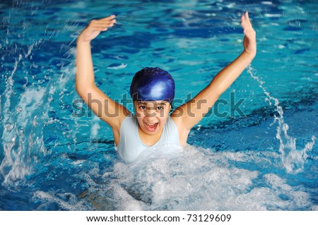 Activities on the pool, children swimming and playing, girl splashing water - stock photo