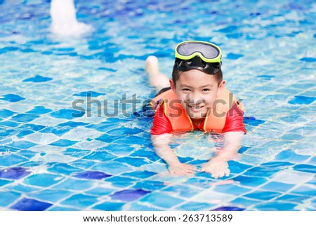 Activities on the pool, children swimming and playing in water, happiness in summertime - stock photo