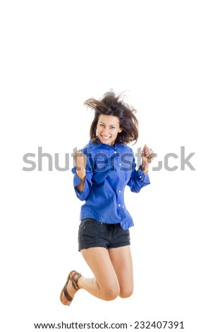 activity and happiness concept , successful smiling teenage girl or woman happy for her success in blue blank shirt and jeans shorts jumping