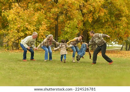 Activity happy family relaxing in autumn forest - stock photo