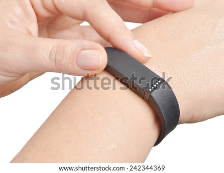 Activity tracker on a woman's wrist - stock photo