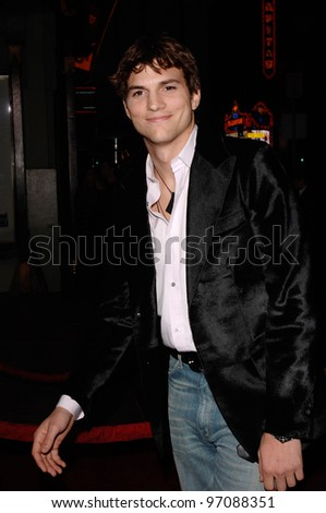 Actor ASHTON KUTCHER at the Los Angeles premiere of his new movie Guess Who, at the Grauman's Chinese Theatre, Hollywood. March 13, 2005: Los Angeles, CA.  2005 Paul Smith / Featureflash - stock photo