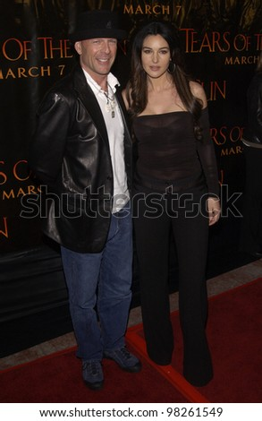 Actor BRUCE WILLIS & actress MONICA BELLUCCI at the Los Angeles premiere of their new movie Tears of the Sun. 03MAR2003.   Paul Smith / Featureflash - stock photo