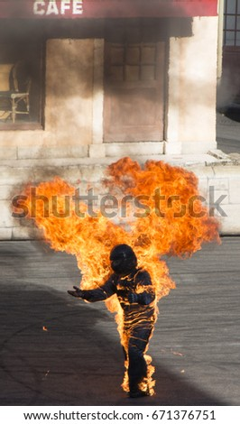 Actor burning man during stunt scene