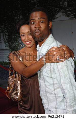 Actor/comedian CHRIS ROCK & wife at the Los Angeles premiere of Hustle & Flow at the Cinerama Dome, Hollywood. July 20, 2005  Los Angeles, CA  2005 Paul Smith / Featureflash - stock photo