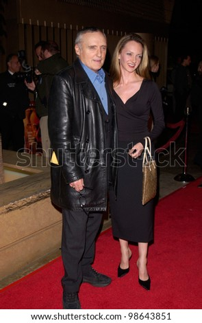 Actor DENNIS HOPPER & wife at the world premiere, in Hollywood, of The Pledge. 09JAN2001.   Paul Smith/Featureflash