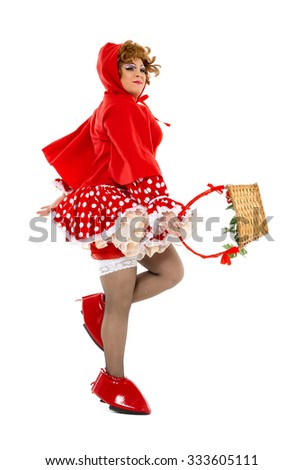 Actor Drag Queen Dressed as Little Red Riding Hood, on white background - stock photo