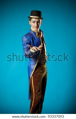 actor in an embroidered caftan welcomed the audience. - stock photo