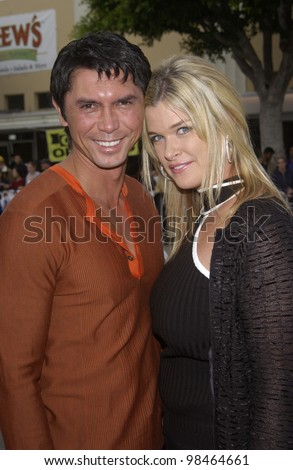 Actor LOU DIAMOND PHILLIPS & wife KELLY at the Los Angeles premiere of his new movie Hollywood Homicide. June 10, 2003  Paul Smith / Featureflash